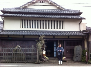 Yashima-san at the brewery entrance